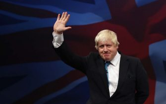MANCHESTER, ENGLAND - OCTOBER 06:  London mayor Boris Johnson waves after speaking to conference on the third day of the Conservative party conference on October 6, 2015 in Manchester, England. The third day of the 2015 autumn conference is being dominated by tough new measures to deal with mass immigration in the Conservative conference speech.  (Photo by Dan Kitwood/Getty Images)