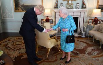 TOPSHOT - Britain's Queen Elizabeth II welcomes newly elected leader of the Conservative party, Boris Johnson during an audience in Buckingham Palace, London ON jULY 24, 2019, where she invited him to become Prime Minister and form a new government. - Theresa May is set to formally resign on July 24 after taking her final PMQs in the House of Commons with Boris Johnson taking charge at 10 Downing Street on a mission to deliver Brexit by October 31 with or without a deal. (Photo by Victoria Jones / POOL / AFP) (Photo by VICTORIA JONES/POOL/AFP via Getty Images)