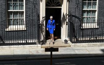 Britain's outgoing prime minister Theresa May emerges to make a speech outside 10 Downing street in London on July 24, 2019 before formally tendering her resignation at Buckingham Palace. - Theresa May is set to formally resign on July 24 after taking her final PMQs in the House of Commons with Boris Johnson taking charge at 10 Downing Street on a mission to deliver Brexit by October 31 with or without a deal. (Photo by Ben STANSALL / AFP)        (Photo credit should read BEN STANSALL/AFP via Getty Images)