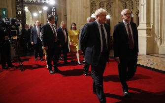 LONDON, ENGLAND - OCTOBER 14: British Prime Minister Boris Johnson (CL) and main opposition Labour Party leader Jeremy Corbyn (CR) head the procession of members of parliament through the Peers Lobby into the House of Lords to listen to the Queen's Speech during the State Opening of Parliament in the Houses of Parliament on October 14, 2019 in London, England. The Queen's speech is expected to announce plans to end the free movement of EU citizens to the UK after Brexit, new laws on crime, health and the environment. (Photo by Tolga Akmen - WPA Pool/Getty Images)