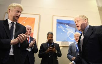 LONDON, ENGLAND - JUNE 12: Boris Johnson (R) is congratulated by his brother, Jo Johnson MP (L) launching his Conservative Party leadership campaign at the Academy of Engineering on June 12, 2019 in London, England. (Photo by Leon Neal/Getty Images)