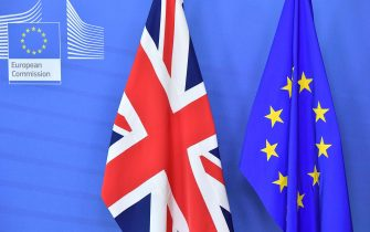 A picture taken on October 17, 2018 shows the United Kingdom (Union Jack) flag set past the EU flag before the arrival of Britain's Prime Minister Theresa May and President of the European Commission Jean-Claude Juncker at the European Commission in Brussels. - British Prime Minister Theresa May is due to address a summit of European Union leaders in which Brexit negotiations are expected to be top of the agenda. (Photo by EMMANUEL DUNAND / AFP) (Photo by EMMANUEL DUNAND/AFP via Getty Images)