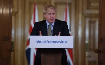 LONDON, ENGLAND - MARCH 18: British Prime Minister Boris Johnson gestures as he gives a press conference about the ongoing situation with the coronavirus (COVID-19) outbreak inside 10 Downing Street on March 18, 2020 in London, England. (Photo by Eddie Mulholland - WPA Pool/Getty Images)