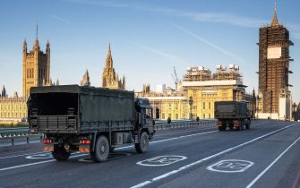 LONDON, UNITED KINGDOM - MARCH 24: Military vehicles cross Westminster Bridge after members of the 101 Logistic Brigade of the British Army delivered a consignment of medical masks to St Thomas' hospital on March 24, 2020 in London, England. British Prime Minister, Boris Johnson, announced strict lockdown measures urging people to stay at home and only leave the house for basic food shopping, exercise once a day and essential travel to and from work. The Coronavirus (COVID-19) pandemic has spread to at least 182 countries, claiming over 10,000 lives and infecting hundreds of thousands more. (Photo by Leon Neal/Getty Images)