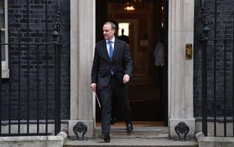 """Britain's Foreign Secretary Dominic Raab leaves number 10 Downing street in central London after the daily Covid-19 briefing on April 15, 2020. - The new leader of Britain's opposition Labour Party urged the government today to set out how it plans to end the coronavirus lockdown, both to give people hope and avoid """"mistakes"""" of the past. (Photo by DANIEL LEAL-OLIVAS / AFP) (Photo by DANIEL LEAL-OLIVAS/AFP via Getty Images)"""