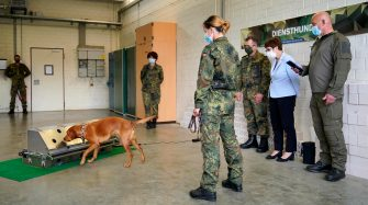 epa08564001 German Minister of Defence Annegret Kramp-Karrenbauer (2-R) watching a dog's training session during her visit to a School for Service Dogs of the Bundeswehr in Ulmen near Koblenz, Germany, 24 July 2020. In the German Bundeswehr Graefin-von-Maltzan barracks in Ulmen, service dogs are being trained as sniffer dogs for the coronavirus Covid-19.  EPA/RONALD WITTEK