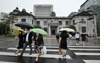 Pedestrians cross the road in front of the Bank of Korea in Seoul on July 23, 2020. - South Korea's economy recorded its worst performance in more than 20 years in the second quarter, the central bank said on July 23, as the coronavirus pandemic hammered its exports. (Photo by Jung Yeon-je / AFP) (Photo by JUNG YEON-JE/AFP via Getty Images)