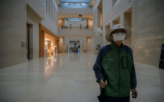 A visitor wearing a face mask walks through the National Museum of Korea in Seoul on July 23, 2020. - Cultural venues in Seoul have re-opened following a slowdown in COVID-19 coronavirus infections, emerging from lockdown for the second time since the start of the pandemic after an uptick in local cases in late May. As part of virus-related restrictions on visitor numbers, Seoul's National Museum of Korea is operating a reservation system allowing up to 200 visitors into exhibitions in two-hour viewing sessions. (Photo by Ed JONES / AFP) (Photo by ED JONES/AFP via Getty Images)