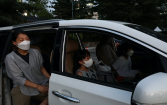 SEOUL, SOUTH KOREA - JULY 17: A family watch a concert from their car at a drive-in concert operation by South Korean cultural heritage administration as South Koreans take measures to protect themselves against the spread of coronavirus (COVID-19) on July 17, 2020 in Seoul, South Korea. South Korea's new daily virus cases came in at around 60 for the second straight day on Friday as the country grapple with rising imported cases and an uptick in local infections. The country added 60 cases tody, including 21 local infections, raising the total caseload to 13,672, according to the Korea Centers for Disease Control and Prevention (KCDC). (Photo by Chung Sung-Jun/Getty Images)