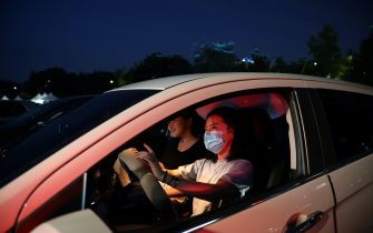 SEOUL, SOUTH KOREA - JULY 17: People watch a concert from their car at a drive-in concert operation by South Korean cultural heritage administration as South Koreans take measures to protect themselves against the spread of coronavirus (COVID-19) on July 17, 2020 in Seoul, South Korea. South Korea's new daily virus cases came in at around 60 for the second straight day on Friday as the country grapple with rising imported cases and an uptick in local infections. The country added 60 cases tody, including 21 local infections, raising the total caseload to 13,672, according to the Korea Centers for Disease Control and Prevention (KCDC). (Photo by Chung Sung-Jun/Getty Images)