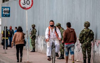 Colombian soldiers patrol the streests, during the rotating lockdowns within the Covid-19 pandemic, in Bogota, on July 23, 2020. - The mayor of Bogota, Claudia Lopez, expanded a coronavirus lockdown from Thursday to cover five million residents of the Colombian capital after the government refused to authorize a total shutdown. Bogota is trying to avoid the collapse of its intensive care facilities which have reached 91.5 percent occupancy, according to official figures. (Photo by Juan BARRETO / AFP) (Photo by JUAN BARRETO/AFP via Getty Images)