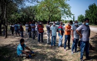 ROME, ITALY - JULY 11: Bangladeshi community wait for Coronavirus swabs (Covid-19) at a testing center of ASL Roma 2 after several positive cases in recent days, on July 11, 2020 in Rome, Italy. Bangladesh community in Rome is cooperating with regional health authorities, with large numbers of Bangladeshis adhering to the call from the Lazio Region to undergo voluntary testing for Coronavirus (Covid-19). (Photo by Antonio Masiello/Getty Images)