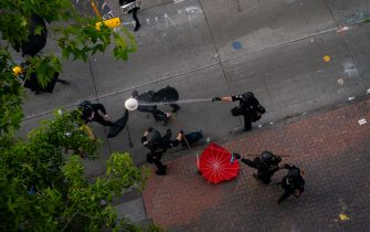 SEATTLE, WA - JULY 25: Police disperse demonstrators with pepper spray during protests in Seattle on July 25, 2020 in Seattle, Washington. Police and demonstrators clash as protests continue in the city following reports that federal agents may have been sent to the city. (Photo by David Ryder/Getty Images)