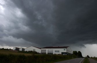 Dark clouds move over a farm near the small Bavarian village of Mamming, where an outbreak of COVID-10 coronavirus cases has raised, southern Germany, on July 26, 2020. - A total of 174 seasonal workers on a large Bavarian farm in the municipality of Mamming have tested positive for the coronavisrus COVID-19 and some 500 are in quarantine to contain a mass coronavirus outbreak. (Photo by Christof STACHE / AFP) (Photo by CHRISTOF STACHE/AFP via Getty Images)