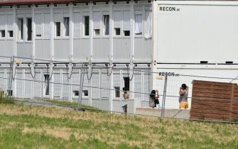 Exterior view shows the accommodation containers of a farm's seasonal workers that are secured from the outside world with a fence on July 27, 2020  in Mamming, southern Germany, after an outbreak of COVID-10 coronavirus cases has raised. - At least 174 seasonal workers have tested positive for the virus on the farm in the municipality of Mamming, most of them from Hungary, Romania, Bulgaria and Ukraine, and some 500 workers were sent into quarantine on the Bavarian farm at the weekend to contain a mass coronavirus outbreak. (Photo by Christof STACHE / AFP) (Photo by CHRISTOF STACHE/AFP via Getty Images)