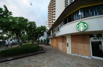 A Starbucks shop is pictured boarded up in preparation for Hurricane Douglas in Honolulu, Hawaii, on July 25, 2020. - Douglas is expected to be a category 1 hurricane with winds 74 to 95mph (119 to 152kph), as it approaches the islands this weekend. (Photo by Ronen Zilberman / AFP) (Photo by RONEN ZILBERMAN/AFP via Getty Images)
