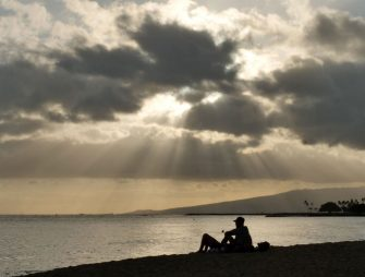 People enjoy sunset on Waikiki Beach in Honolulu, Hawaii, on July 25, 2020, as Hurricane Douglas approaches. - Douglas is expected to be a category 1 hurricane with winds 74 to 95mph (119 to 152kph), as it approaches the islands this weekend. (Photo by Ronen Zilberman / AFP) (Photo by RONEN ZILBERMAN/AFP via Getty Images)