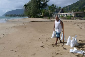 Carlos Mozo fills sand bags in preparation for flooding from hurricane Douglas in Hau'ula on the windward side of Oahu, Hawaii, July 25, 2020. - Douglas is expected to be a category 1 hurricane with winds 74 to 95mph (119 to 152kph), as it approaches the islands this weekend. (Photo by Ronen Zilberman / AFP) (Photo by RONEN ZILBERMAN/AFP via Getty Images)