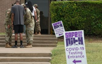 Members of the Texas Army and Air National Guard run a COVID-19 testing site at Paul Quinn College in Dallas, Texas on July 29, 2020. - The testing site has conducted over 5,000 tests, handed out over 3,000 boxes of food with an average of 500 tests a day since it opened in June. (Photo by Bryan R. Smith / AFP) (Photo by BRYAN R. SMITH/AFP via Getty Images)