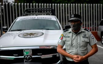 A Mexican National Guard officer is on guard in front of the Pedregal de Angeles Hospital, where according to local media, the former executive director of Mexico's state oil company, PEMEX, Emilio Lozoya, is being treated for health problems in the second day of his judicial hearing on corruption charges, in Mexico City, on July 29, 2020, amid the novel coronavirus pandemic. (Photo by PEDRO PARDO / AFP) (Photo by PEDRO PARDO/AFP via Getty Images)