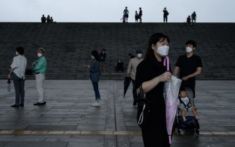 Visitors wearing face masks arrive at the National Museum of Korea in Seoul on July 23, 2020. - Cultural venues in Seoul have re-opened following a slowdown in COVID-19 coronavirus infections, emerging from lockdown for the second time since the start of the pandemic after an uptick in local cases in late May. As part of virus-related restrictions on visitor numbers, Seoul's National Museum of Korea is operating a reservation system allowing up to 200 visitors into exhibitions in two-hour viewing sessions. (Photo by Ed JONES / AFP) (Photo by ED JONES/AFP via Getty Images)
