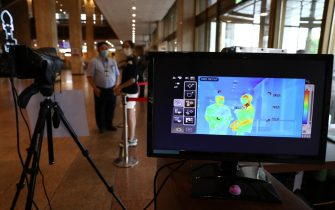 SEOUL, SOUTH KOREA - JULY 21: Audience walk past a thermal camera in light of the coronavirus at a Sejong Culture Center ahead of musical 'Mozart' on July 21, 2020 in Seoul, South Korea. With the number of daily local cases recently hovering around 20 or below, but imported cases continued to rise by double digit figures. South Korea resumed operations of some museums and libraries in the greater Seoul area starting yeaterday. Health authorities, however, are still vigilant over the spread of the virus in vacation spots over the summer, pointing out that the season will serve as a critical juncture for the nation's anti-virus fight. The country added 45 cases toddy, including 20 local infections, raising the total caseload to 13,816, according to the Korea Centers for Disease Control and Prevention (KCDC). (Photo by Chung Sung-Jun/Getty Images)