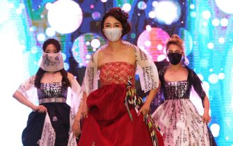 SEOUL, SOUTH KOREA - JULY 24: Models wearing face mask walk the runway during the 2020 Korea Mask Fashion Show amid coronavirus pandemic at the Riverside Hotel on July 24, 2020 in Seoul, South Korea. The country added a further 41 Covid-19 cases today, including 28 local infections, raising the total caseload to 13,979, according to the Korea Centers for Disease Control and Prevention (KCDC). (Photo by Chung Sung-Jun/Getty Images)