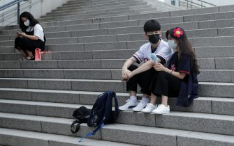 SEOUL, SOUTH KOREA - JULY 26: Lotte Giants fans wear face masks ahead of the KBO League game between Lotte Giants and Kiwoom Heroes at the Gocheok Sky Dome on July 26, 2020 in Seoul, South Korea. South Korean baseball start accepting fans to stadiums, ahead of other sports after new coronavirus pandemic, up to 10 percent of its capacity. (Photo by Han Myung-Gu/Getty Images)