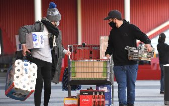People push their trolleys outside a Costco outlet in Melbourne on August 2, 2020 as shoppers queue for provision with the Victorian state government expected to annouce harsh new restrictions due to the city battling fresh outbreaks of the COVID-19 coronavirus. (Photo by William WEST / AFP) (Photo by WILLIAM WEST/AFP via Getty Images)