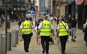 """Metrolink workers wear high vis jackets with that urge social distancing as a precuation against the transmission of the novel coronavirus in Manchester, northwest England, on July 31, 2020. - Britain today """"put the brakes on"""" easing lockdown measures and imposed new rules on millions of households in northern England, following concerns over a spike in coronavirus infections. (Photo by Oli SCARFF / AFP) (Photo by OLI SCARFF/AFP via Getty Images)"""