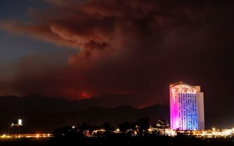 Morongo Casino scrolls gambling messages across the building as the Apple fire burns further into national forest territory in Cabazon, California on August 2, 2020. - More than 1,300 firefighters were battling a blaze that was burning out of control August 2 in southern California, threatening thousands of people and homes east of Los Angeles. The so-called Apple Fire that broke out Friday near the city of San Bernardino has so far charred more than 20,000 acres (8,000 hectares), sending up columns of smoke visible from far away. (Photo by JOSH EDELSON / AFP) (Photo by JOSH EDELSON/AFP via Getty Images)