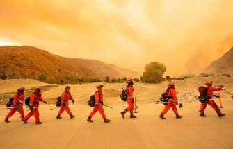 TOPSHOT - Inmate firefighters arrive at the scene of the Water fire, a new start about 20 miles from the Apple fire in Whitewater, California on August 2, 2020. - More than 1,300 firefighters were battling a blaze that was burning out of control August 2 in southern California, threatening thousands of people and homes east of Los Angeles. The so-called Apple Fire that broke out Friday near the city of San Bernardino has so far charred more than 20,000 acres (8,000 hectares), sending up columns of smoke visible from far away. (Photo by JOSH EDELSON / AFP) (Photo by JOSH EDELSON/AFP via Getty Images)