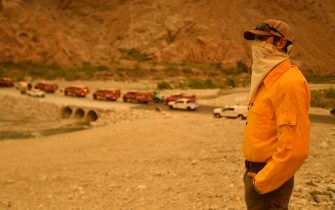 Whitewater Preserve Manager Kerry Puckett watches as firefighters arrive at the scene of a new start about 20 miles from the Apple fire in Whitewater, California on August 2, 2020. - Puckett says the fire started out of nowhere and immediately grew out of control due to high heat, wind and low humidity. (Photo by JOSH EDELSON / AFP) (Photo by JOSH EDELSON/AFP via Getty Images)