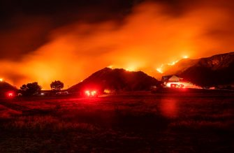 TOPSHOT - In this long exposure photograph, firefighters monitor flames as they skirt a hillside near a residential area during the Apple fire in Banning, California on August 1, 2020. - 4,125 acres have burn in Cherry Valley, about 2,000 people have received evacuation orders in the afternoon of August 1.  Around 8PM the fire spread to 12,000 acres. (Photo by JOSH EDELSON / AFP) (Photo by JOSH EDELSON/AFP via Getty Images)