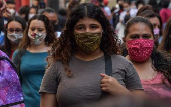 People walk along a commercial street, in downtown Sao Paulo, Brazil on August 4, 2020, amid the new coronavirus pandemic. - Brazil enters its sixth months of pandemic with almost 100,000 people dead and without any perspective of ending the tragedy, which some see as the inevitable consequence of the lack of national leadership to face it. (Photo by NELSON ALMEIDA / AFP) (Photo by NELSON ALMEIDA/AFP via Getty Images)