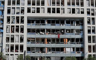 The damaged facade of Annahar newspaper building is seen following yesterday's blast at the port of Lebanon's capital Beirut, on August 5, 2020. - Rescuers worked through the night after two enormous explosions ripped through Beirut's port, killing at least 78 people and injuring thousands, as they wrecked buildings across the Lebanese capital. (Photo by ANWAR AMRO / AFP) (Photo by ANWAR AMRO/AFP via Getty Images)