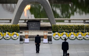 Japanese Prime Minister Shinzo Abe (C) bows in front of the Memorial Cenotaph after delivering a speech during the 75th anniversary memorial service for atomic bomb victims at the Peace Memorial Park in Hiroshima on August 6, 2020. - Japan on August 6, 2020 marked 75 years since the world's first atomic bomb attack, with the COVID-19 coronavirus pandemic forcing a scaling back of annual ceremonies to commemorate the victims. (Photo by Philip FONG / AFP) (Photo by PHILIP FONG/AFP via Getty Images)