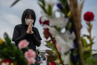 HIROSHIMA, JAPAN - AUGUST 06: A woman prays in remembrance during the 75th anniversary of the Hiroshima atomic bombing, on August 6, 2020 in Hiroshima, Japan. In a ceremony that has been scaled back significantly because of Covid-19 coronavirus, Japan will mark the 75th anniversary of the first atomic bomb that was dropped by the United States on Hiroshima on August 6, 1945. The bomb instantly killed an estimated 70,000 people and thousands more in coming years from radiation effects. Three days later the United States dropped a second atomic bomb on Nagasaki which ended World War II. (Photo by Carl Court/Getty Images)