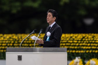 HIROSHIMA, JAPAN - AUGUST 06: Japanese Prime Minister, Shinzo Abe, makes a speech during the 75th anniversary of the Hiroshima atomic bombing, on August 6, 2020 in Hiroshima, Japan. In a ceremony that has been scaled back significantly because of Covid-19 coronavirus, Japan will mark the 75th anniversary of the first atomic bomb that was dropped by the United States on Hiroshima on August 6, 1945. The bomb instantly killed an estimated 70,000 people and thousands more in coming years from radiation effects. Three days later the United States dropped a second atomic bomb on Nagasaki which ended World War II. (Photo by Carl Court/Getty Images)
