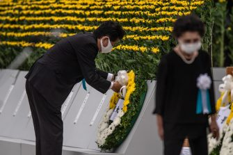 HIROSHIMA, JAPAN - AUGUST 06: Japanese Prime Minister, Shinzo Abe, lays a wreath during the 75th anniversary of the Hiroshima atomic bombing, on August 6, 2020 in Hiroshima, Japan. In a ceremony that has been scaled back significantly because of Covid-19 coronavirus, Japan will mark the 75th anniversary of the first atomic bomb that was dropped by the United States on Hiroshima on August 6, 1945. The bomb instantly killed an estimated 70,000 people and thousands more in coming years from radiation effects. Three days later the United States dropped a second atomic bomb on Nagasaki which ended World War II. (Photo by Carl Court/Getty Images)