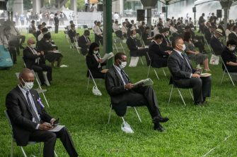 HIROSHIMA, JAPAN - AUGUST 06: People sit in socially distanced chairs as a precaution against coronavirus as they as they attend the 75th anniversary of the Hiroshima atomic bombing, on August 6, 2020 in Hiroshima, Japan. In a ceremony that has been scaled back significantly because of Covid-19 coronavirus, Japan will mark the 75th anniversary of the first atomic bomb that was dropped by the United States on Hiroshima on August 6, 1945. The bomb instantly killed an estimated 70,000 people and thousands more in coming years from radiation effects. Three days later the United States dropped a second atomic bomb on Nagasaki which ended World War II. (Photo by Carl Court/Getty Images)