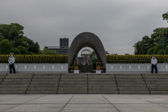 HIROSHIMA, JAPAN - AUGUST 06: Security guards stand at either side of the Hiroshima Victims Memorial Cenotaph ahead of the ceremony to mark the 75th anniversary of the Hiroshima atomic bombing, on August 6, 2020 in Hiroshima, Japan. In a ceremony that has been scaled back significantly because of Covid-19 coronavirus, Japan will mark the 75th anniversary of the first atomic bomb that was dropped by the United States on Hiroshima on August 6, 1945. The bomb instantly killed an estimated 70,000 people and thousands more in coming years from radiation effects. Three days later the United States dropped a second atomic bomb on Nagasaki which ended World War II. (Photo by Carl Court/Getty Images)