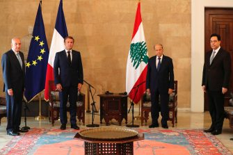 French President Emmanuel Macron (2L) meets with Lebanese President Michel Aoun (2R) upon his arrival at Beirut airport, on August 6, 2020 two days after a massive explosion devastated the Lebanese capital in a disaster that has sparked grief and fury. - French President Emmanuel Macron visited shell-shocked Beirut on August 6, pledging support and urging change after a massive explosion devastated the Lebanese capital in a disaster that left 300,000 people homeless. (Photo by Thibault Camus / POOL / AFP) (Photo by THIBAULT CAMUS/POOL/AFP via Getty Images)