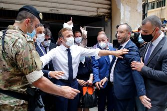 French President Emmanuel Macron (C), gestures as he visits a devastated street of Beirut, Lebanon, on August 6, 2020 two days after a massive explosion devastated the Lebanese capital in a disaster that has sparked grief and fury. - French President Emmanuel Macron visited shell-shocked Beirut, pledging support and urging change after a massive explosion devastated the Lebanese capital in a disaster that has sparked grief and fury. (Photo by Thibault Camus / POOL / AFP) (Photo by THIBAULT CAMUS/POOL/AFP via Getty Images)