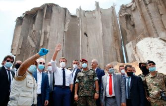 French President Emmanuel Macron (4L), surrounded by Lebanese servicemen, gestures as he visits the devastated site of the explosion at the port of Beirut, on August 6, 2020 two days after a massive explosion devastated the Lebanese capital in a disaster that has sparked grief and fury. - French President Emmanuel Macron visited shell-shocked Beirut on August 6, pledging support and urging change after a massive explosion devastated the Lebanese capital in a disaster that left 300,000 people homeless. (Photo by Thibault Camus / POOL / AFP) (Photo by THIBAULT CAMUS/POOL/AFP via Getty Images)