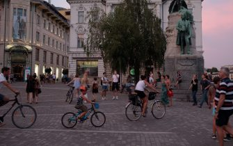 LJUBLJANA, SLOVENIA - JULY 31: Cyclists on Preernov Trg in Ljubljana, the capital of Slovenia on July 31, 2020 in Ljubljana, Slovenia. The number of people using bicycles to commute has risen since the COVID-19 epidemic was declared in March 2020. Slovenians on bicycles have been protesting for weeks, as the spread of COVID-19 has coincided with the return to power of the right-wing Prime Minister Janez Jansa. (Photo by Matic Zorman/Getty Images)