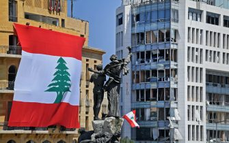 A Lebanese flag is seen on the Le Gray hotel next to the Martyrs' Monument in downtown Beirut, on August 7, 2020, four days after a monster explosion killed more than 150 people and disfigured the Lebanese capital. - A fire at Beirut port on August 4 ignited a stock of ammonium nitrate and triggered an explosion that was felt in neighbouring countries and destroyed entire neighbourhoods of the city. (Photo by - / AFP) (Photo by -/AFP via Getty Images)