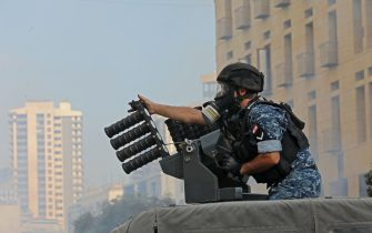 A member of the Lebanese security forces loads tear gas into a launcher during clashes in downtown Beirut on October8, 2020, following a demonstration against a political leadership they blame for a monster explosion that killed more than 150 people and disfigured the capital Beirut. (Photo by Anwar AMRO / AFP) (Photo by ANWAR AMRO/AFP via Getty Images)