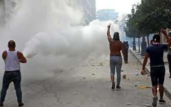 Lebanese protesters gesture towards security forces during clashes in downtown Beirut on October8, 2020, following a demonstration against a political leadership they blame for a monster explosion that killed more than 150 people and disfigured the capital Beirut. (Photo by Anwar AMRO / AFP) (Photo by ANWAR AMRO/AFP via Getty Images)
