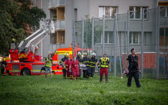 Firefighters carry a stretcher at the scene where a fire broke out in an apartment block in Bohumin, eastern Czech Republic on August 8, 2020, killing eleven people including three children. - Police originally reported ten dead in the fire in a 13-storey concrete block of flats in the city of Bohumin on the Czech-Polish border some 300 kilometres (190 miles) east of the capital Prague. (Photo by Lukas Kabon / AFP) (Photo by LUKAS KABON/AFP via Getty Images)